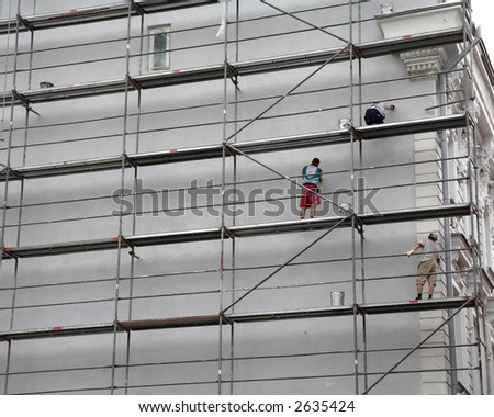 Worker Fixing Wall Tallinn Estonia - stock photo