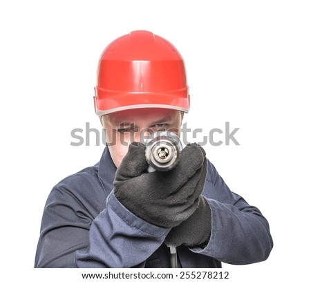 Worker holding electric drill and wearing hard hat. Aims drill. Isolated on white - stock photo
