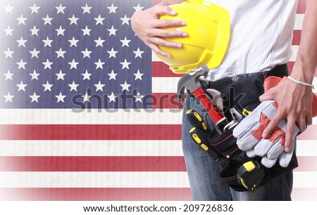 Worker holding tool for working on labor day - stock photo