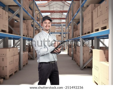 worker in a classic warehouse - stock photo