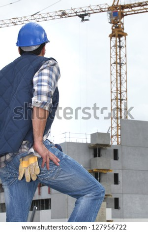 worker in front of crane - stock photo