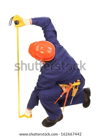 Worker in hard hat measure with ruler. Isolated on a white background. - stock photo