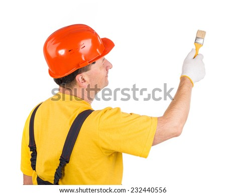Worker in hardhat with paint brush. Isolated on a white background.