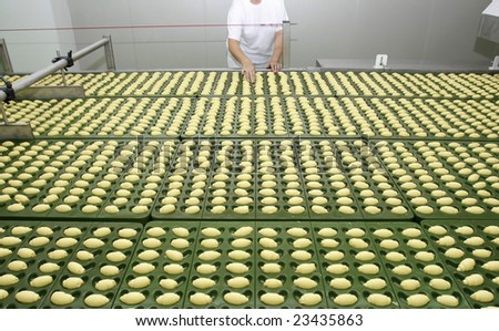 worker in interior of food industry production - stock photo