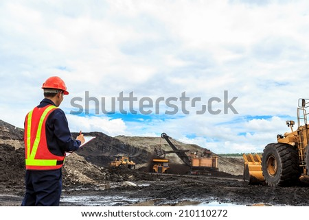 Worker in lignite mine at north of THAILAND - stock photo