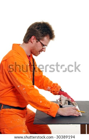 worker in orange workwear measuring with a ruler - stock photo