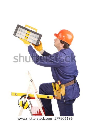 Worker in protective helmet on ladder with toolbox. Isolated on a white background. - stock photo