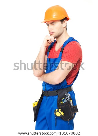 Worker in uniform wearing the helmet  thinking  - isolated on  white background