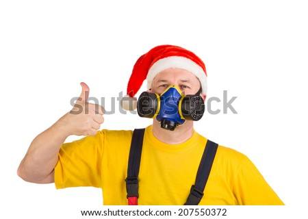 Worker in xmas hat with respirator. Isolated on a white background. - stock photo