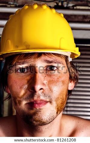 Worker in yellow helmet - stock photo