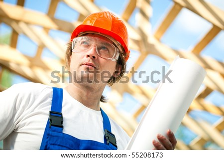 worker looking at the construction project