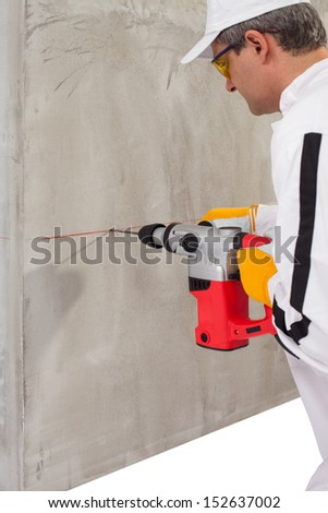 Worker making a hole with a perforator - stock photo