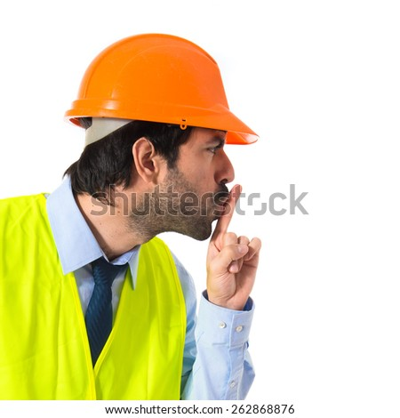 Worker making silence gesture - stock photo