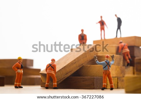 Worker making wood step stair. Success building concept. - stock photo