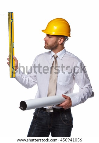 Worker male in yellow safety helmet holding industry level and drawning tube.