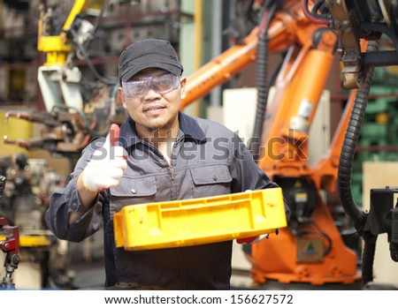 Worker man holding yellow box with giving thumb