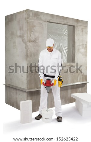 Worker mixing an insulation adhesive - stock photo
