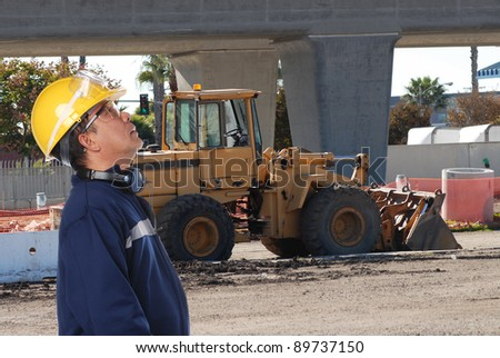 worker on construction site - stock photo