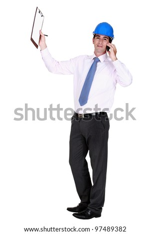 Worker on phone holding a notepad