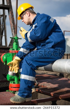 Worker on the oil field. Refinery, oil and gas - stock photo