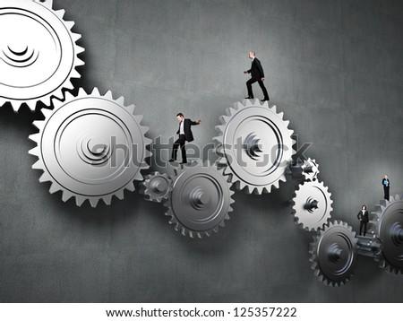 worker people on 3d metal gear - stock photo