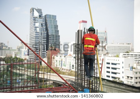 Worker placing reinforcement steel - stock photo
