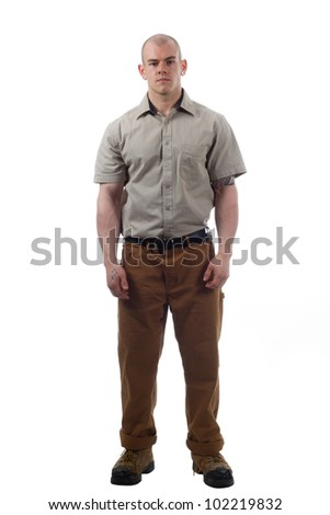worker poses with work uniform - stock photo
