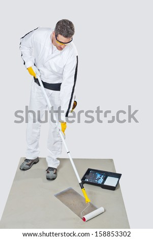 Worker preparing for priming - stock photo