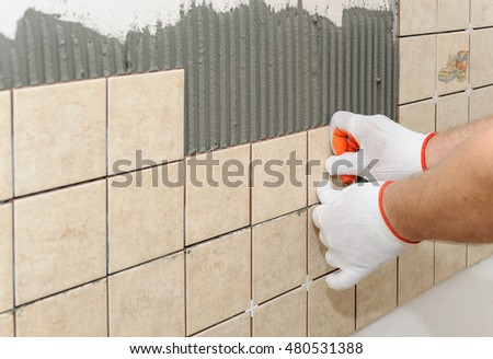 Worker Putting Tiles On Wall Kitchen Stock Photo (Royalty Free ...