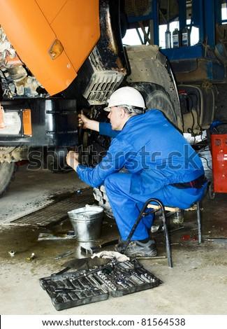 worker repair the truck - stock photo