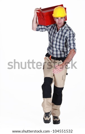 Worker running with a toolbox - stock photo