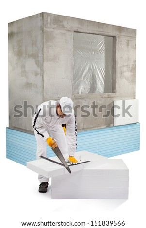 Worker sawing an insulation panel - stock photo