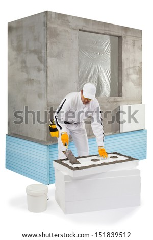Worker spreading a lute on an insulation panel - stock photo