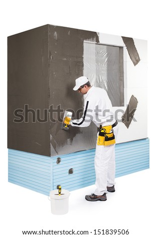 Worker spreading a putty - stock photo