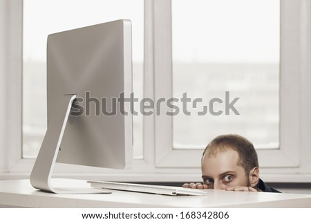worker suspicious with white table - stock photo