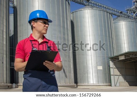 Worker taking a notes  - stock photo