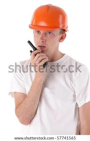 worker talking on portable UHF radio transceiver - stock photo