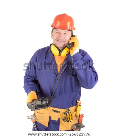 Worker talking on the phone. Isolated on a white background. - stock photo