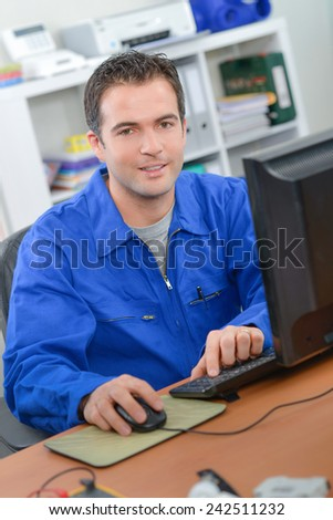 Worker using a computer - stock photo