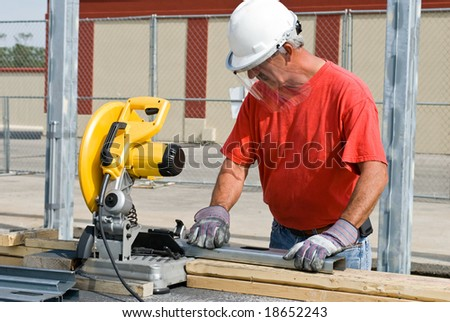 Worker Using Chop Saw
