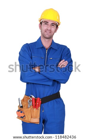 Worker wearing a toolbelt - stock photo
