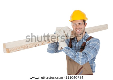 Worker wearing hard hat and carrying timber. Isolated on white - stock photo
