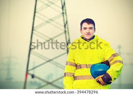 Worker wearing reflective clothing with helmet. - stock photo