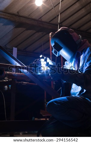 Worker welding aluminum using tig welder