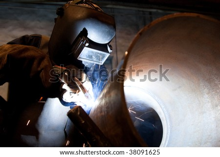 worker welding and sparks spreading - stock photo