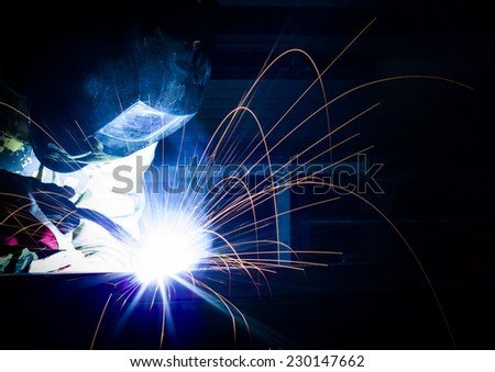 Worker while doing a welding. - stock photo