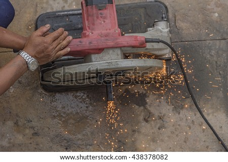 worker while doing a welding outdoor