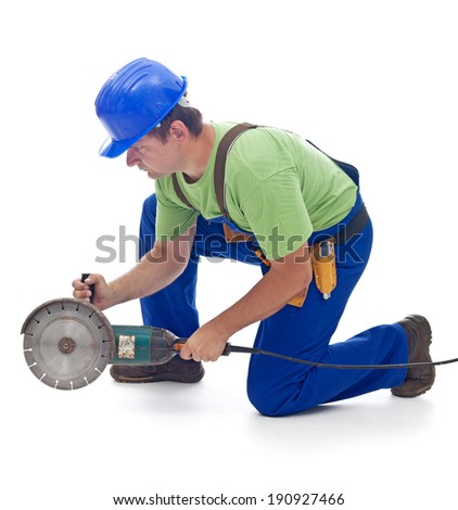 Worker with a power grinder - kneeling to cut something - isolated - stock photo