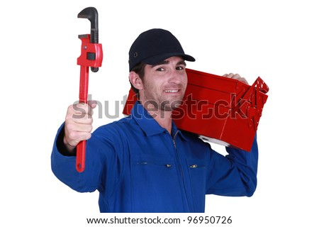 Worker with a toolbox and wrench - stock photo