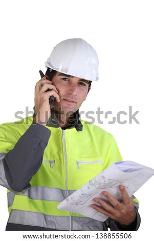 Worker with a walkie talkie - stock photo